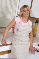 http://allover30women.com/galleries6/570-Allover30-Mature-Leggy-Housewife/ph.html