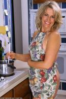 http://allover30women.com/galleries6/579-Allover30-Luscious-Mature-Housewife-Kitchen-Strip/ph.html