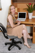 http://allover30women.com/galleries/062-Allover30-Cute-Housewife-Carrie-Plays-Office-Lady/ph.html