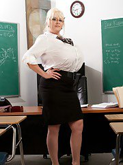 bigtitsmilf pics 2011-03-20 mature-teacher-kayla-kleevage-denudes-her-giant-tits-in-the-classroom