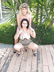exclusivemilf pics lewd-mature-lesbians-on-high-heels-caressing-each-other-outdoor