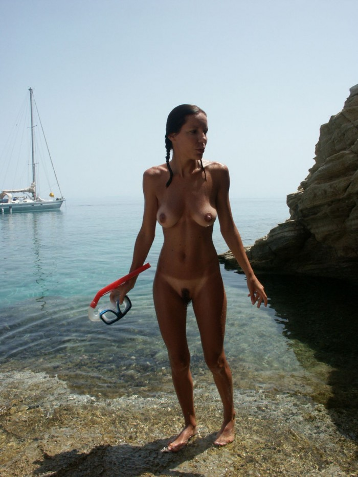 russiasexygirls 21611 sexy-milf-with-nice-body-tans-on-nudist-beach