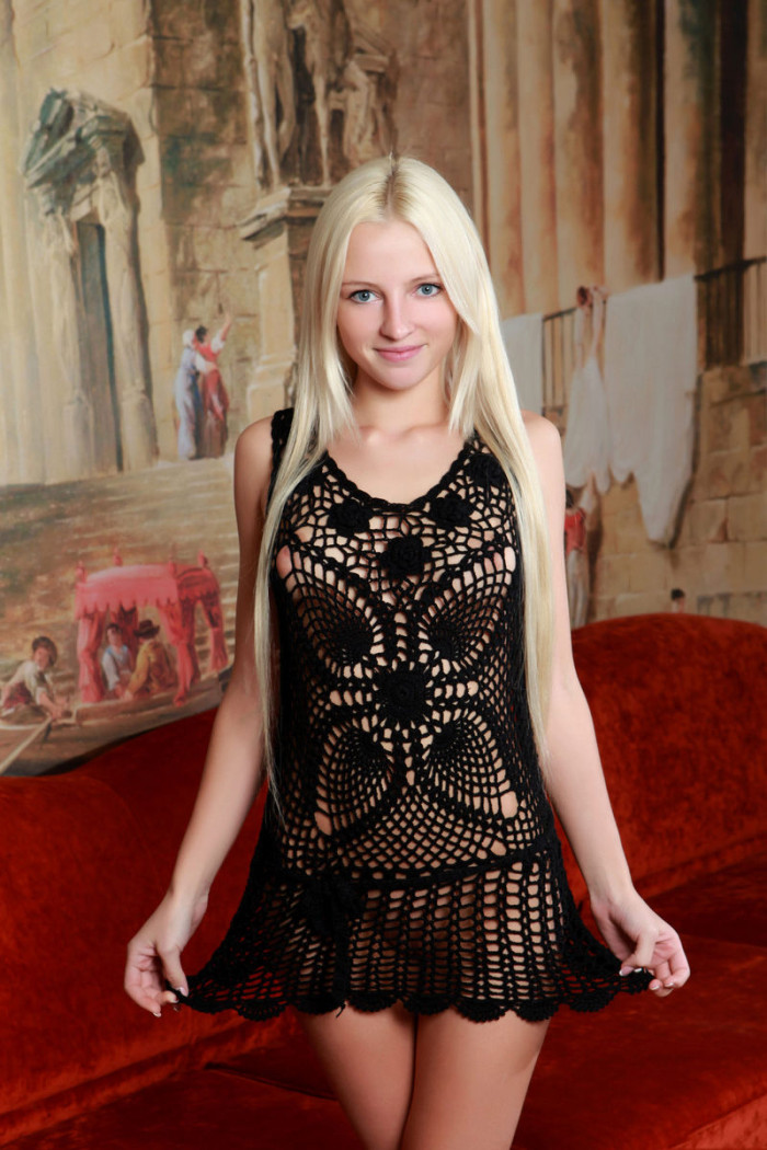 russiasexygirls 139786 sweet-blonde-in-transparent-dress-shows-big-pussy-on-red-sofa