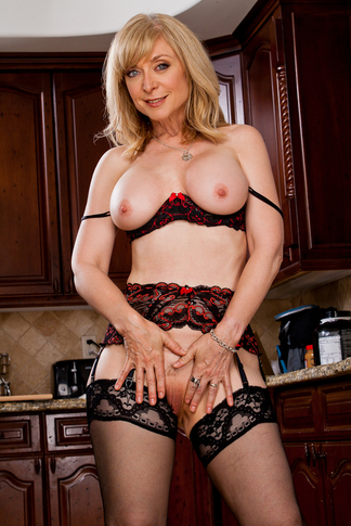 http://galleries.naughtyamerica.com/gallery/us/23/1887/13277/unified_picture/nina_hartley3/