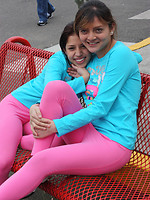 filthyway pics 86164 two-latina-girls-in-tight-pink-leggings-have-fun-in-the-park