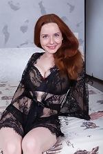 wearehairyfree models Elouisa Elouisa_strips_naked_while_relaxing_in_her_bed