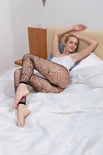 wearehairyfree models Felicia Hairy_woman_Felicia_in_black_fishnet_leggings