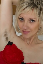 http://www.wearehairyfree.com/models/Sandy_May/Sandy_May_undresses_in_bed_from_lingerie.html