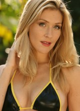 http://www.web-starlets.com/nextdoor-models-emma-jacobs-shows-what-shes-hiding-under-her-shinny-black-bikini/