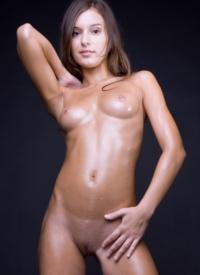 http://www.cherrynudes.com/nikki-oiled-up/