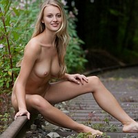 nudeglambabes galleries busty-blonde-carisha-poses-nude-on-the-railroad-tracks