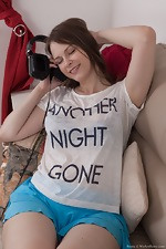 wearehairyfree models Beata Beata_strips_naked_on_her_brown_sofa