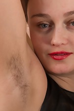 wearehairyfree models Rene Rene_models_her_blue_tights_while_stripping_naked